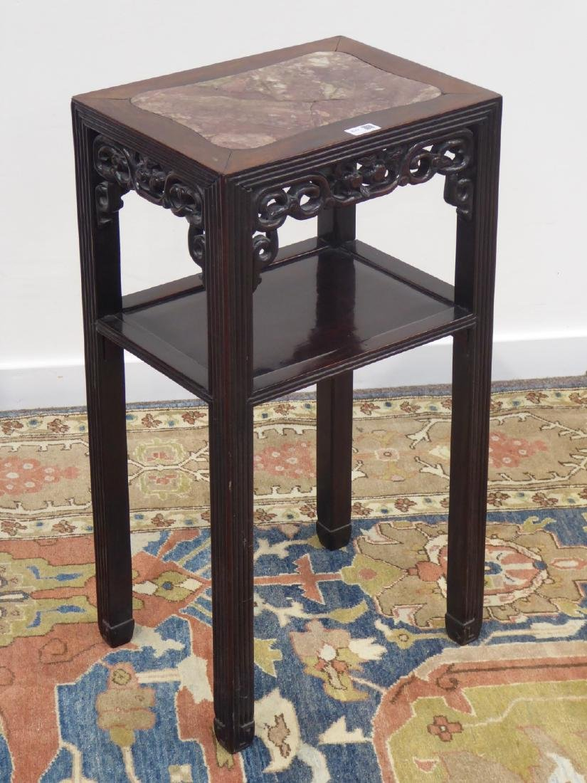 Chinese hardwood two tier occasional table, inset red