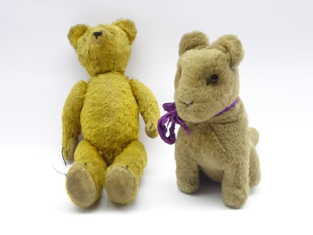 Plush covered straw filled teddy bear with growler,