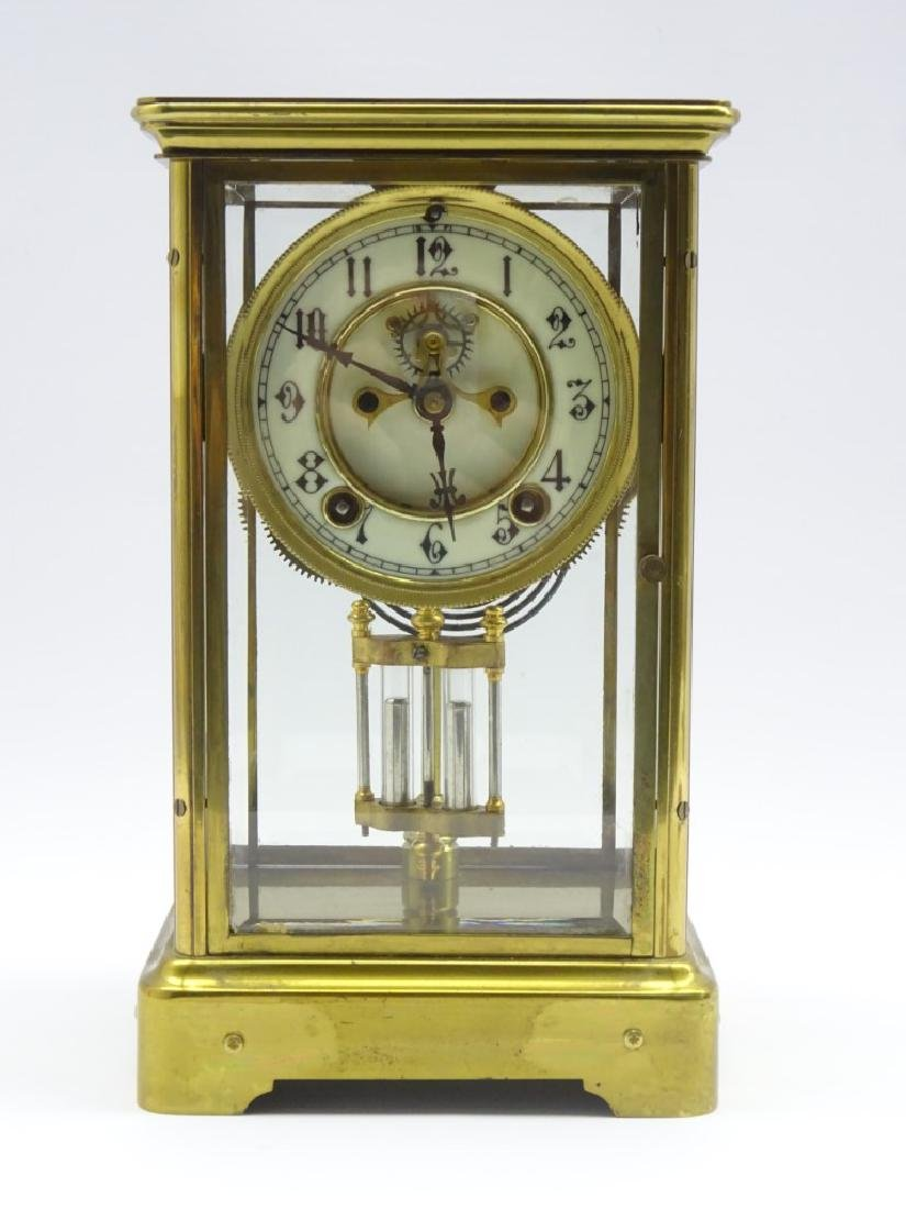 Early 20th century brass four glass mantel clock,