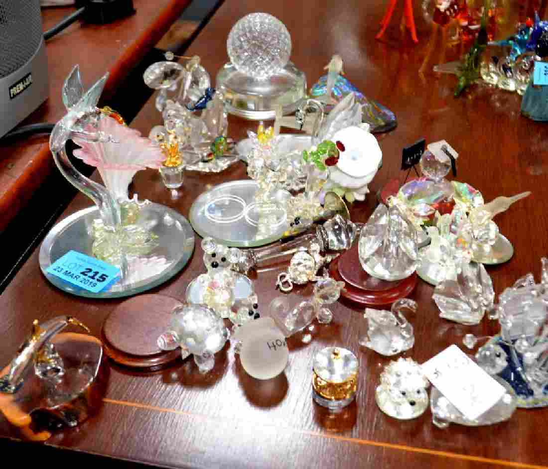 A selection of crystal glass items, mostly animals