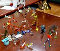 A large collection of glass animals and items