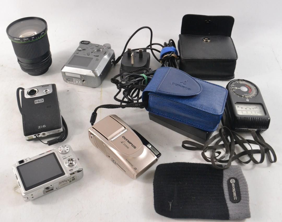 Collection of cameras, light meters, lenses and Beano