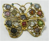Antique costume piece butterfly brooch set with multi
