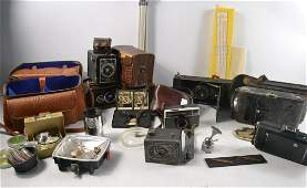 A Selection of vintage cameras and accessories within a