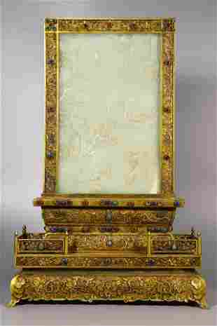 A WHITE JADE AND GILDED BRONZE TABLE SCREEN