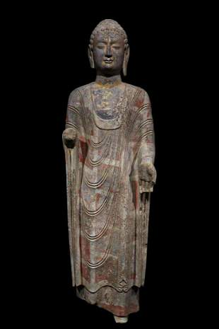 A VINTAGE BUDDHA STATUE MADE OF BLUE STONE