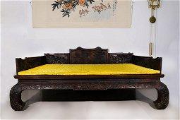 A RED HARDWOOD LOHAN ARHAT BED