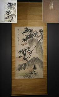 A CHINESE HAND-PAINTED HANGING SCROLL BAMBOO AND ROCK