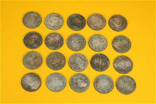 A SET OF 20 SILVER COINS