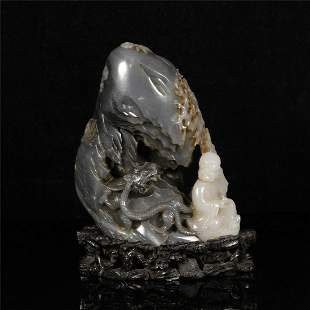 A BLACK AND WHITE INTRICATE DESIGN JADE DISPLAY