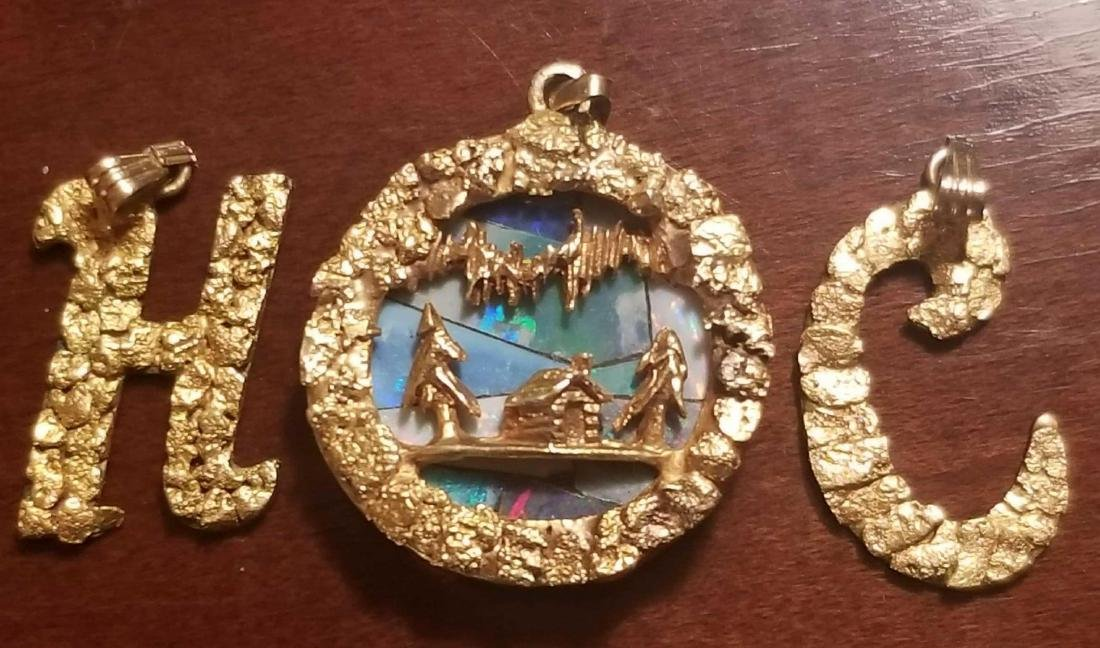 Three pieces of gold nugget jewelry