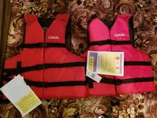 Two new universal adult size Cabela's life jackets