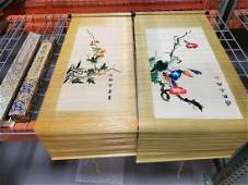 Two Japanese scrolls with floral stitched decoration