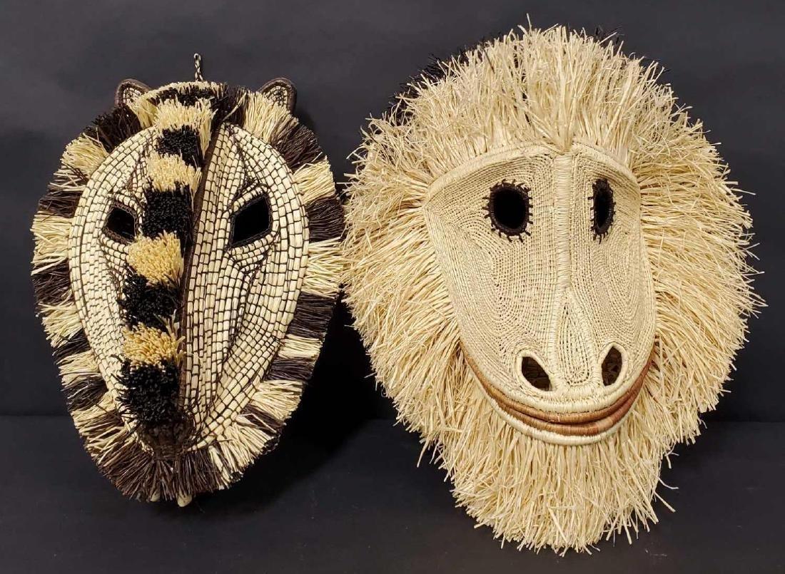 Two Panamanian handmade Embera tribe woven masks