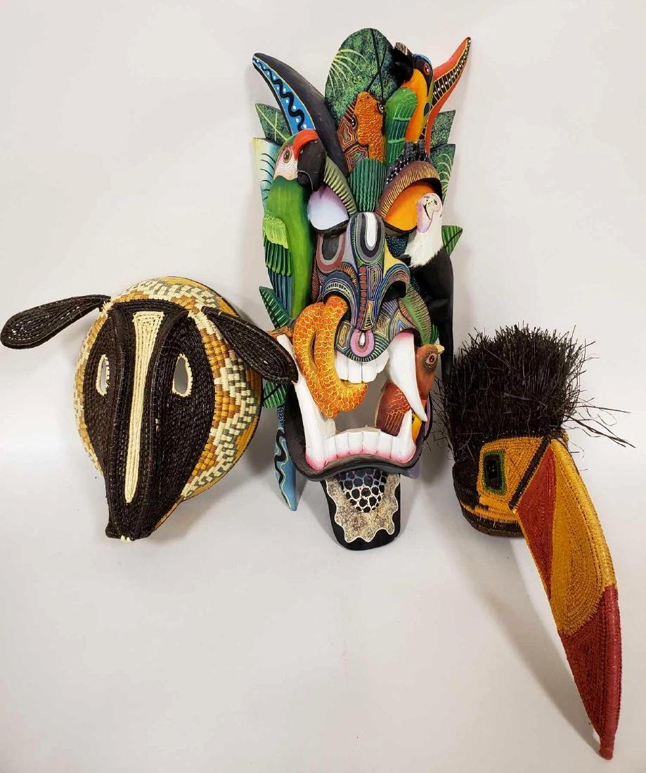 Three South American figural masks