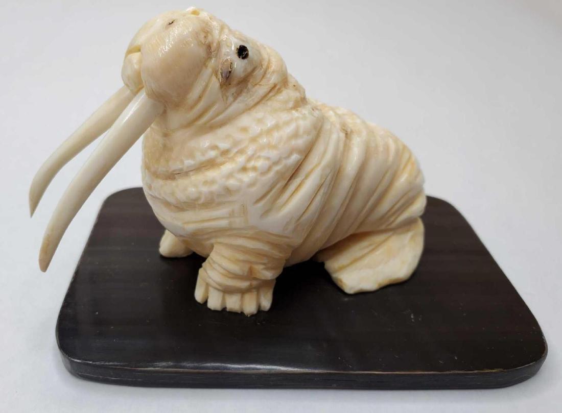 Large Eskimo carved walrus by Dennis Pungowiyi