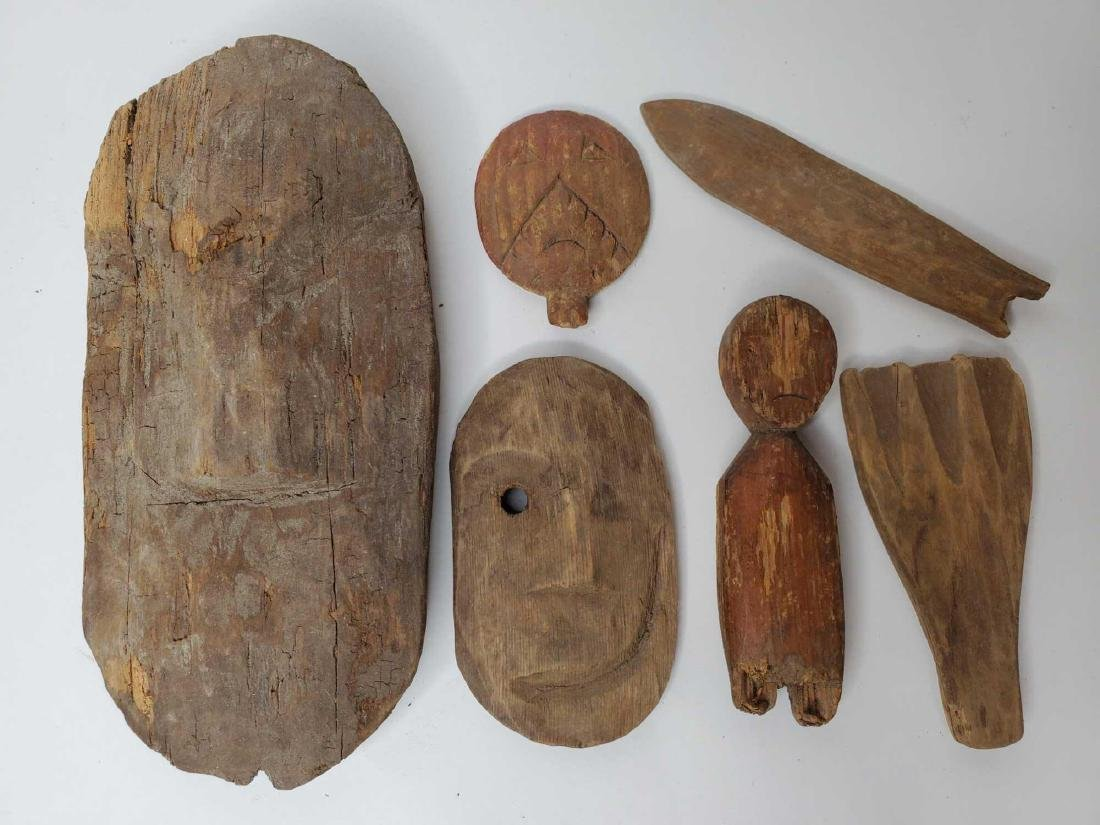 Collection of Eskimo artifact carvings, doll pieces,