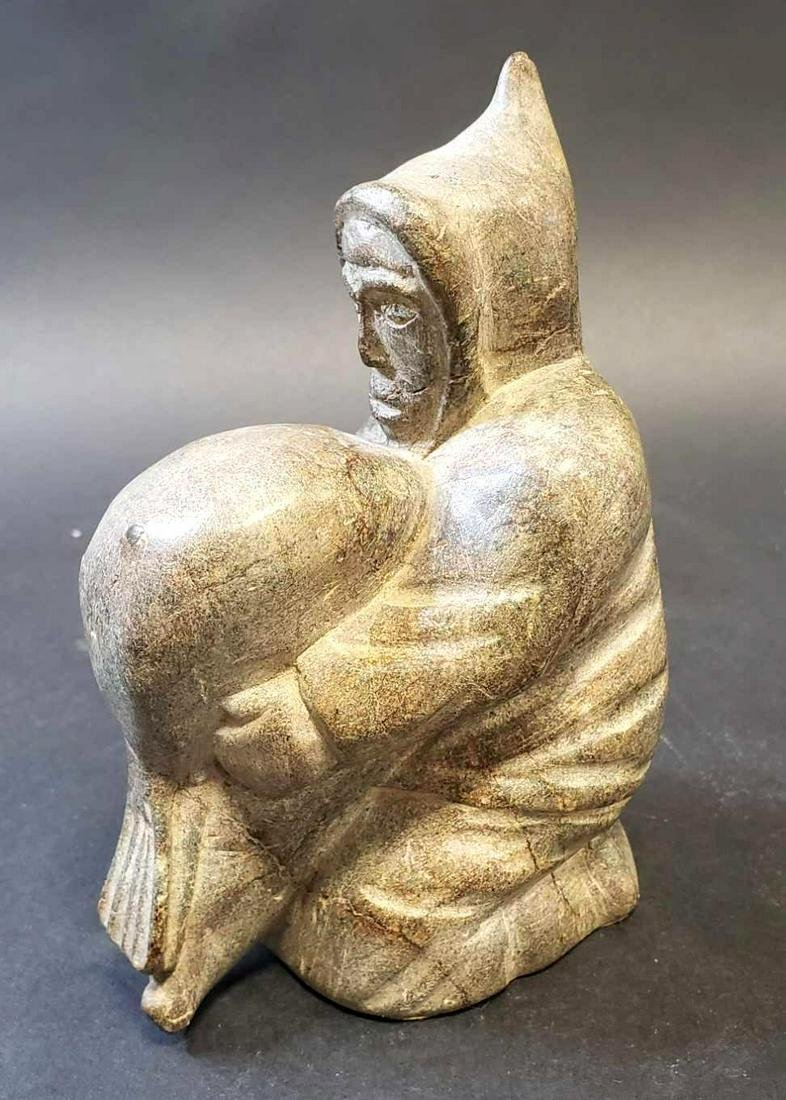 Inuit Soapstone Carving of Hooded Native Man with Seal