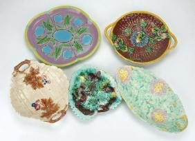 Majolica lot of 4 platters, and one non majolica tray