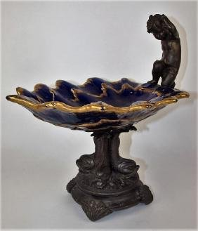 Majolica compote with cast iron base with dolphins and