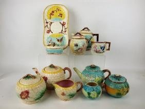 Majoilca lot of 3 teasets, match holder, and tray, 11