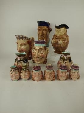 Majolica lot of 12 figural pitchers & decanters