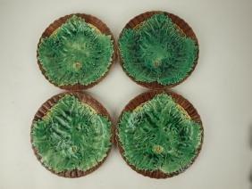 "Majolica set of 4-8 1/2"" maple leaf on wicker plates,"