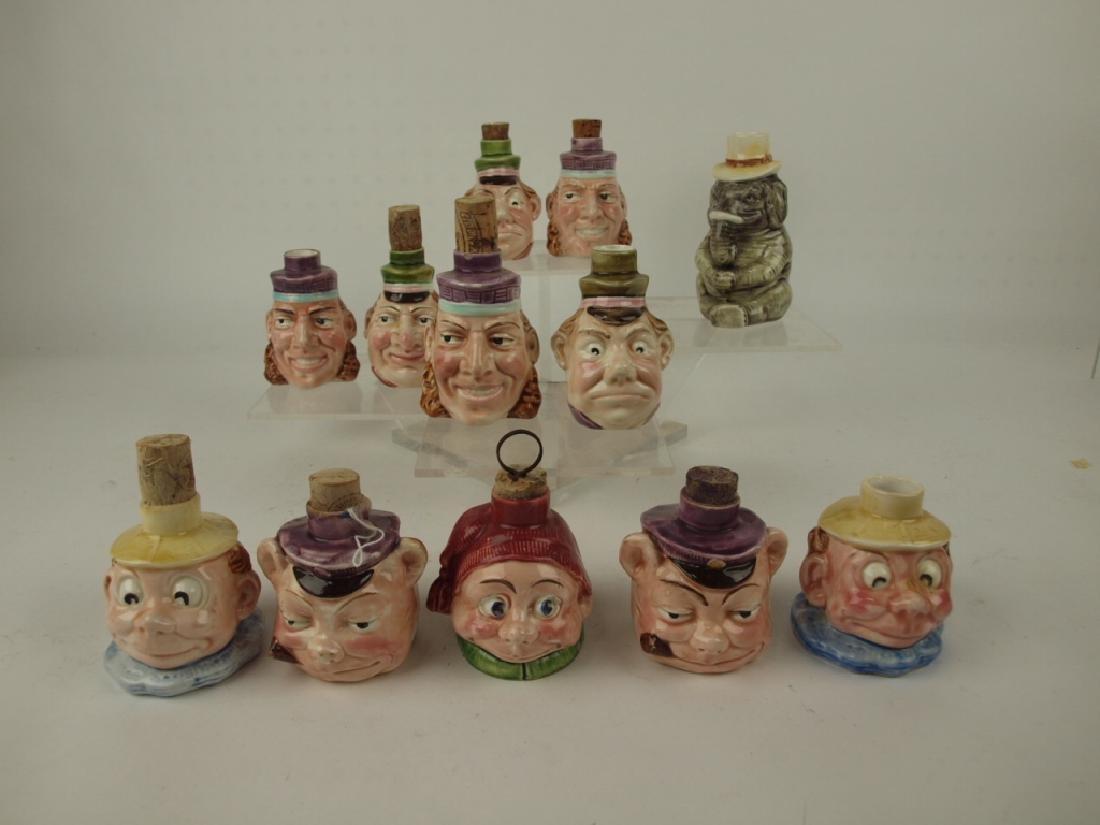 Majolica lot of 12 figural bottles of Palmer Cox