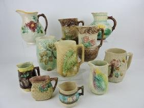 Majolica lot of 11 pitchers and creamers, various