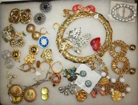 showcase with earrings, brooches, & necklace