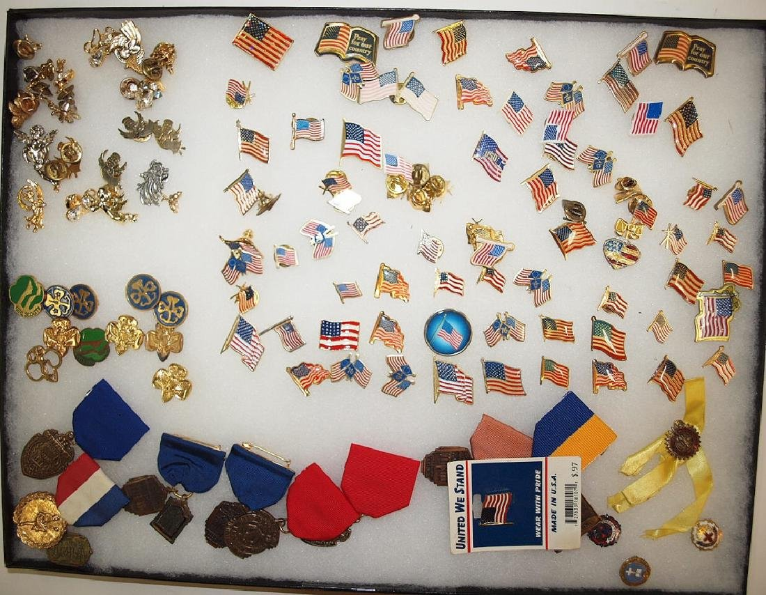 Showcase with flag pins, angel pins, scouting pins and