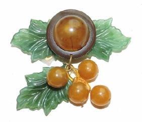 Bakelite brooch with leaf and berries