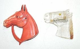 Pair of horse head brooches