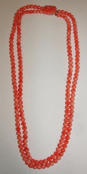 Coral beaded necklace with carved rose coral colors