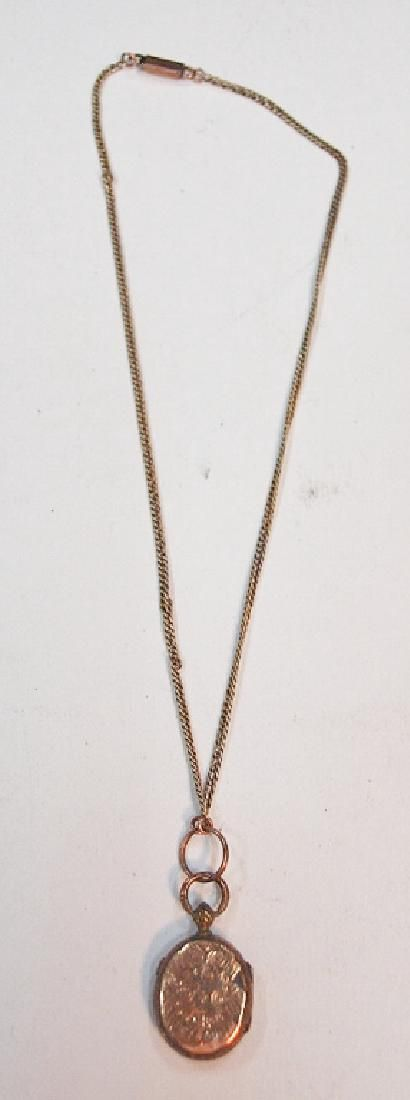 14k gold necklace and gold filled Victorian locket both