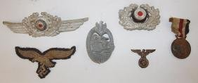 Lot of German military medals, insignia, and patch