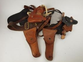 Lot of assorted leather gun holsters and belts, 2
