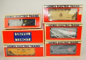 Lionel lot of 6 cars: Milwaukee hopper 6-19302, C & NW
