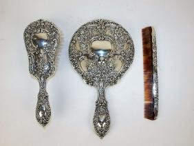 Sterling silver hand mirror, brush, and comb set (comb