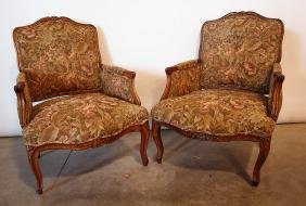 Pair of upholstered arm chairs with wood frames
