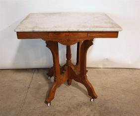 Walnut Victorian marble top parlor table