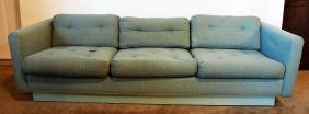 Blue mid century modern floating sofa in the style of