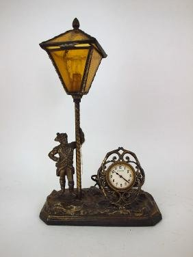 "New Haven novelty clock of ""Minute Man"" stand at lamp"