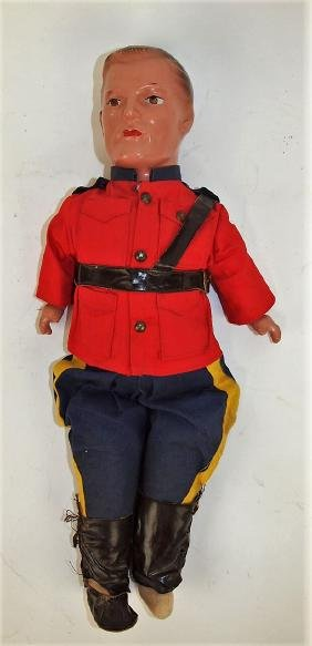 Reliable Canadian Mountie doll in uniform, missing one