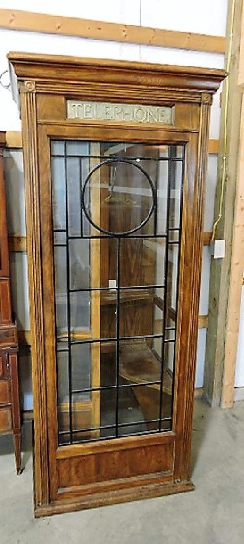 "English oak telephone booth, 80""h, 34""w"