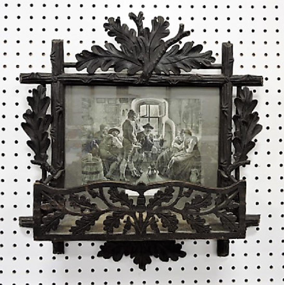 Black Forest carved wall shelf with picture frame,