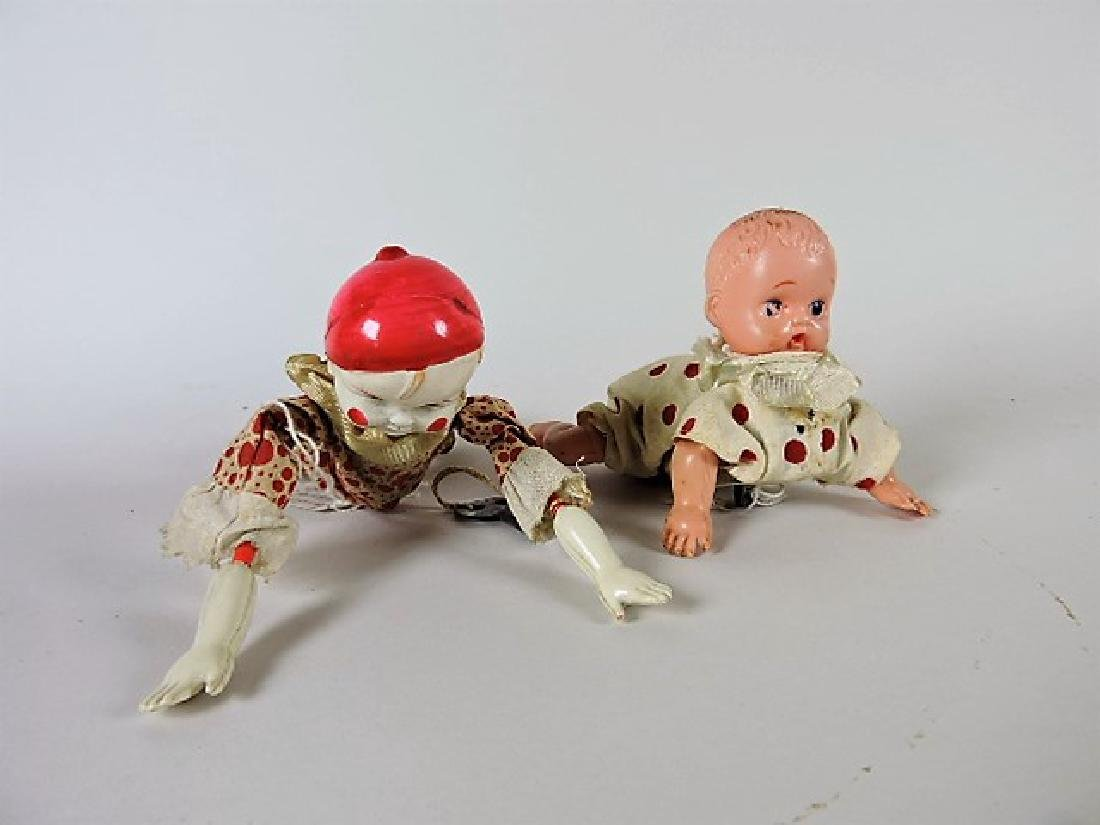Celluloid key wind up tumbling clown toy and celluloid