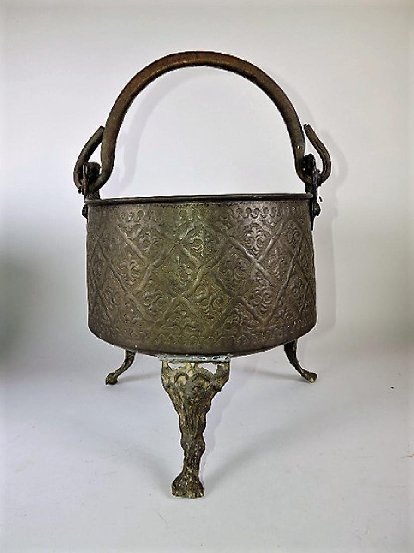 Early brass kettle on legs