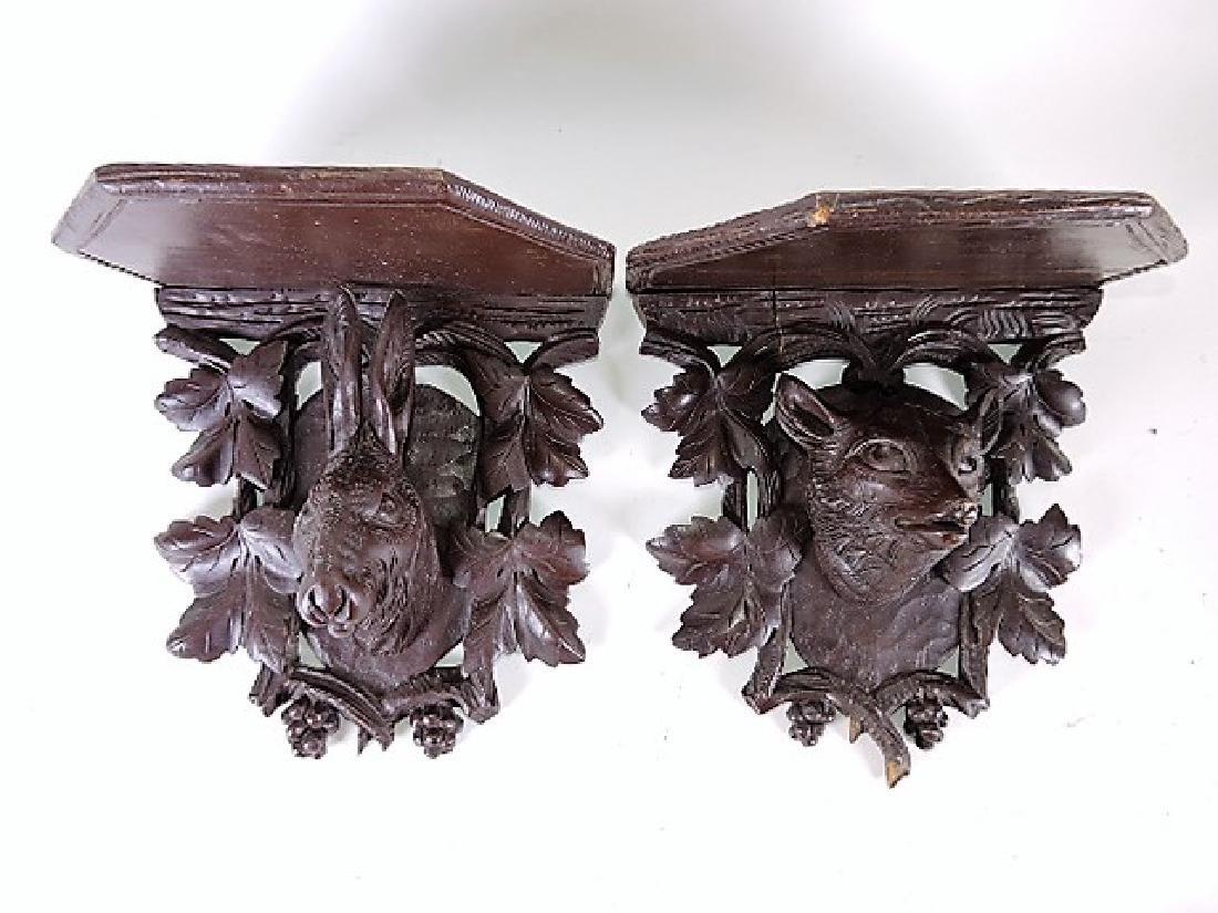 Black Forest carved wooden pair of bracket shelves of