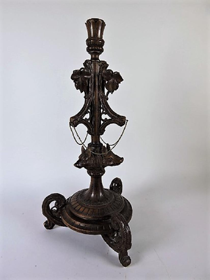 Black Forest carved wooden candle holder with head of